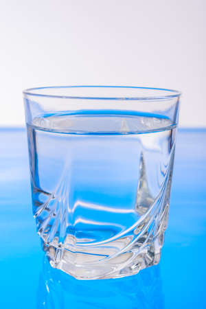 glass with clear water in the studio