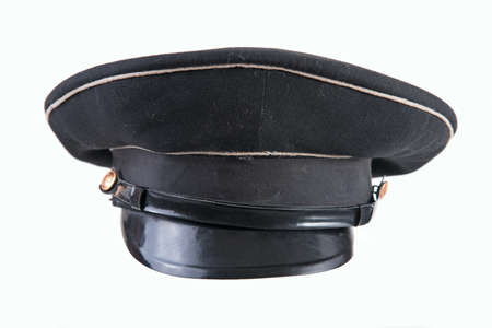 Black headpiece for military personnel, old black military cap in half turn isolated on white background, uniform