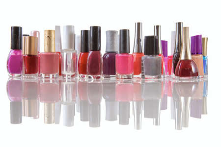 colored nail polishes on an isolated white background with reflection Standard-Bild