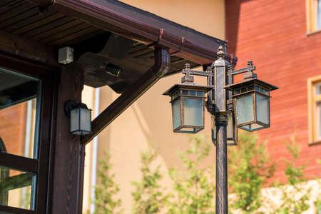 Street lamp near house Standard-Bild