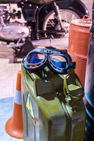 motorcycle glasses on a can of gasoline in the garage