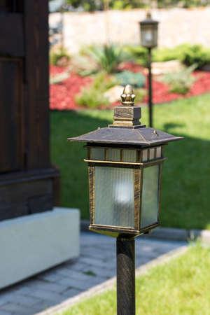 Street lamp in the garden near the house