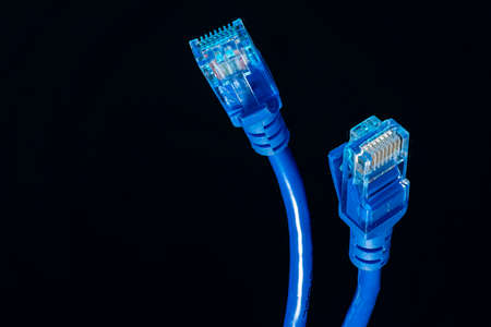 blue Ethernet wire, 8 pin connector for Internet information networks isolated on black background