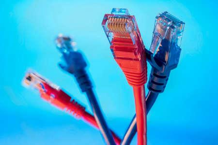 Ethernet connector for internet information networks closeup shot on blue background Archivio Fotografico