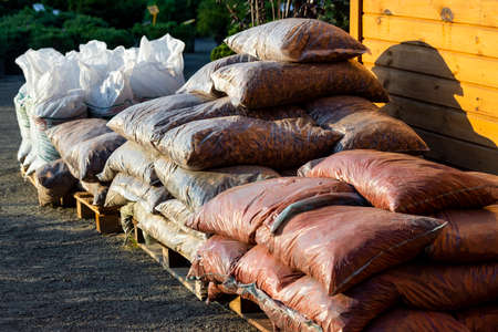 natural wood chips and tree bark for landscape decoration in bags for sale