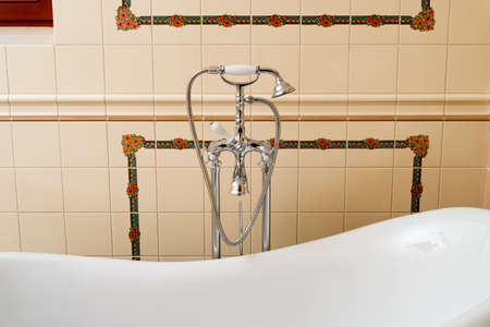 Shower with a tap and hose on pipes