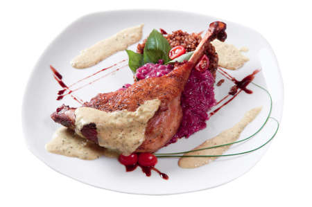 chicken leg with a porridge dressed with sauce on a plate Reklamní fotografie