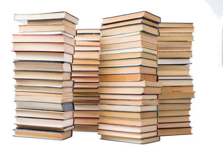 Stack of artistic old books stacked and isolated on white background