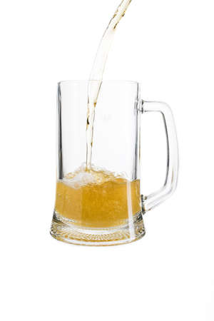 pouring light beer in a glass on an isolated white background Standard-Bild
