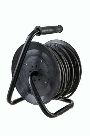electric extension cables with sockets on a reel with a handle isolated on white background