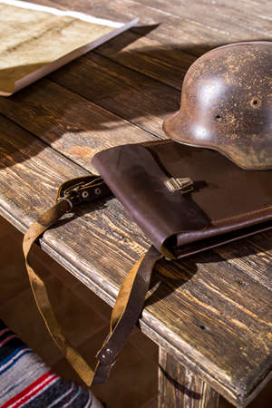 military field officer tablet on a table with a helmet and a map Standard-Bild