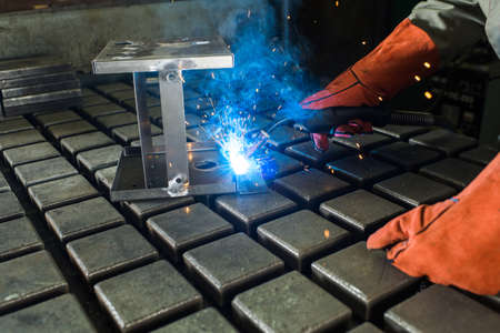 welder in the shop welds detail