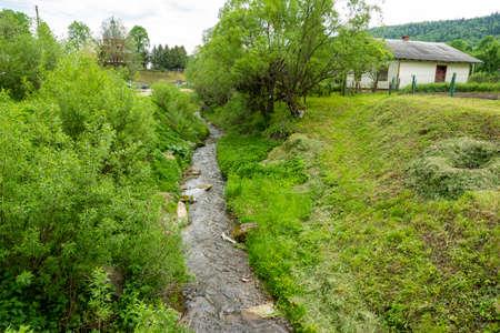 mountain river in the village in the Ukrainian Carpathians Standard-Bild