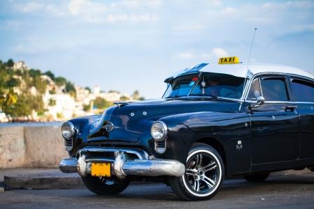 Caribbean American classic car on the promenade in Cuba photo