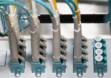 distributor: Fiber optic distributor in a datacenter with cables Stock Photo