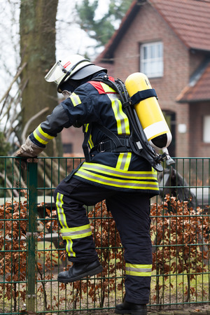 reachability: Firefighter in action Stock Photo