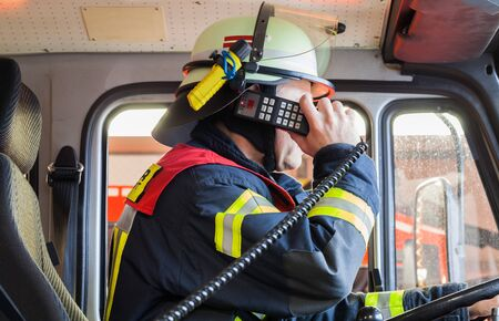 reachability: Firefighter spark in a firetruck Stock Photo