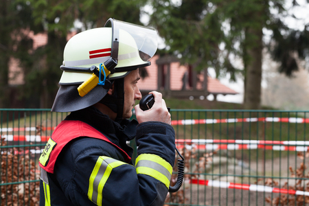 call out: Firefighter with radio set