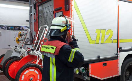 Firefighter in a fire department with radio set photo