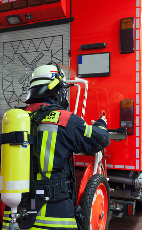 fireproof: Fire Fighter in action with respirator