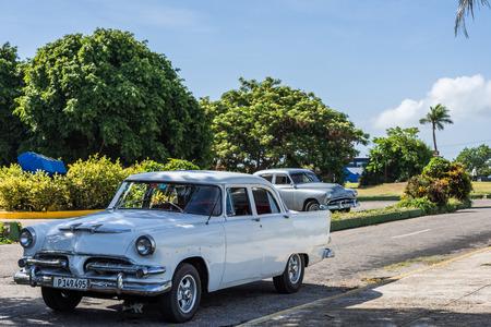 streetlife: White American Classic Car parkedon the street in Varadero Cuba