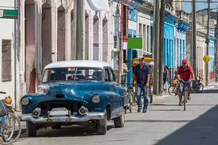 streetlife: Street life in Varadero with a classic car on the street Stock Photo