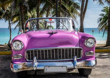Pink american classic convertible in Varadero Cuba