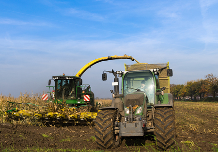 agricultural application tractor: Harvesting with a tractor on the field