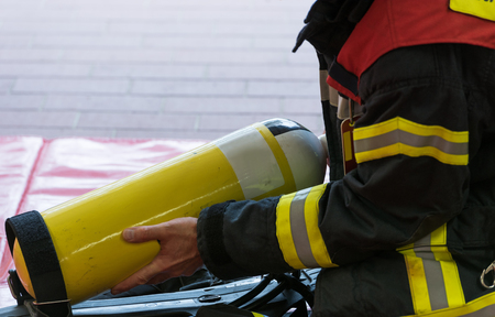 fireproof: Oxygen cylinder in use with a firefighter