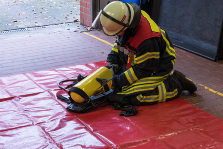 firefighter: Firefighter in the fire department with Oxygen cylinder Stock Photo