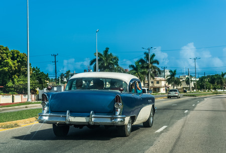 conceptional: American blue vintage car in the backside view on the street in Havana Cuba