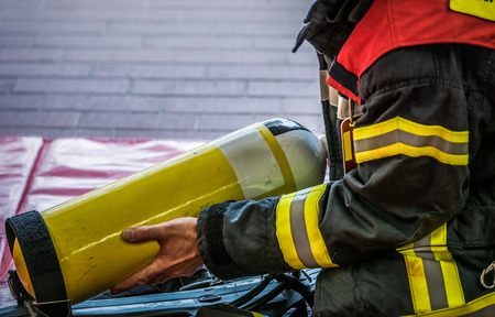 reachability: HDR - Firefighter in action with a oxygen cylinder