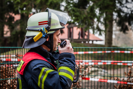 Firefighter used a walkie talkie in action - HDR