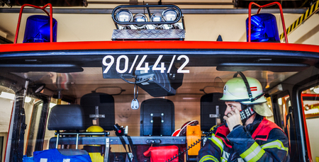 reachability: Firefighter in the fire truck with walkie talkie