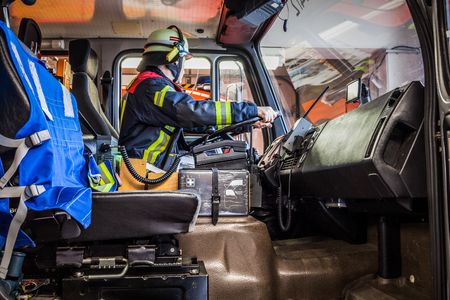 reachability: HDR - Firefighter drives a vehicle with emergency communication interior view Stock Photo