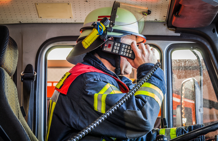 reachability: HDR - Firefighter in action and used a radio Stock Photo