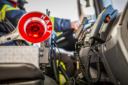 reachability: HDR - Firefighter drives a vehicle with emergency communication interior view and trowel