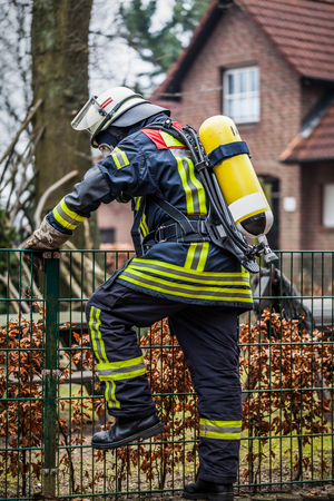 HDR - Firefighter in action with respirator and oxygen cylinder Stock Photo