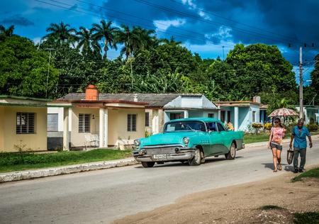 HAVANA, CUBA - JUNE 17, 2015: HDR - Blue american Chevrolet classic car drives through the suburb from Havana Cuba - Serie Cuba Reportage Editorial