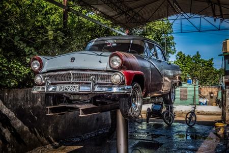 American classic car on the lifting platform in Havana Cuba - Cuba Series Report Editorial