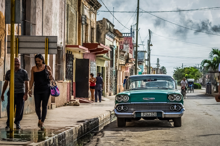Santa Clara, Cuba - June 19, 2015: HDR - Street life view with a american Chevrolet classic car and cuban peoples - Serie Cuba Reportage