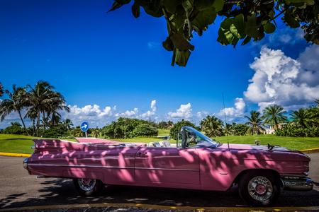 HDR - Pink Cadillac american classic car parked in varadero Cuba - Cuba Series Report