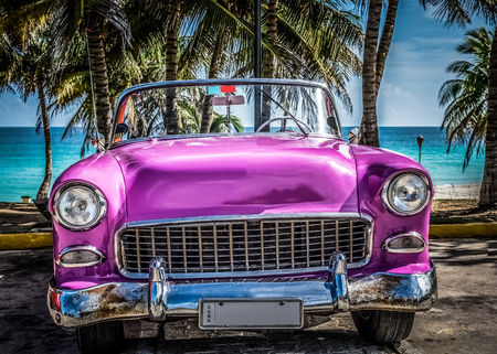 HDR - Pink convertible vintage car in the front view on the beach in Varadero Cuba - Cuba Series Report