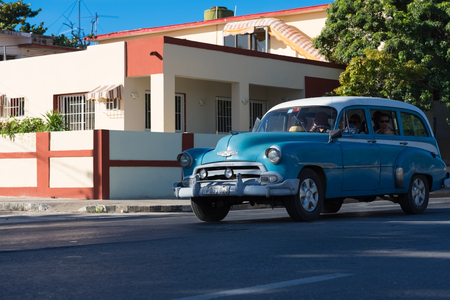 conceptional: American classic car drived on the street through the Varadero Cuba