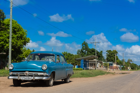 Blue american vintage car parked on the side from the Main Street to Santa Clara - Cuba Series Report