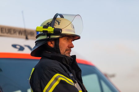 survive: Hamburg, Germany - April 18, 2013: HDR - firefighter chief observed the fire service