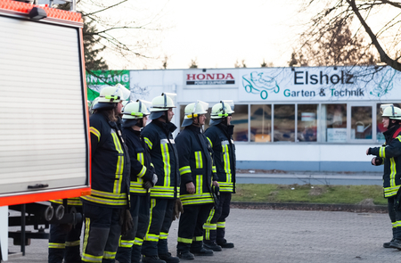 fireproof: Hamburg, Germany - April 18, 2013: HDR - firefighter team lined up at the briefing Editorial