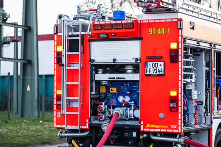 reachability: Hamburg, Germany - April 18, 2013: HDR - fire truck with connected fire hose in action Editorial