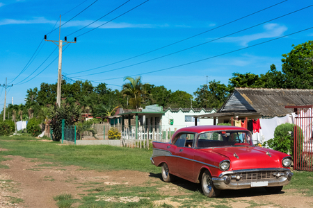 American red classic car parked on the side street in the province Matanzas in Cuba - Series Cuba Reportage Stok Fotoğraf