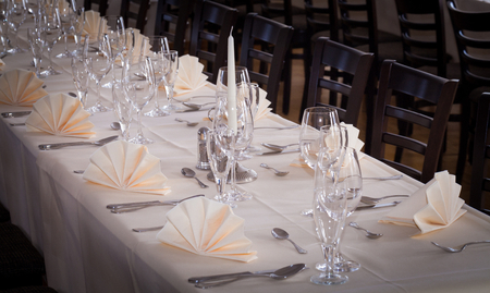 Festive table arrangement with glasses and served and cutlery